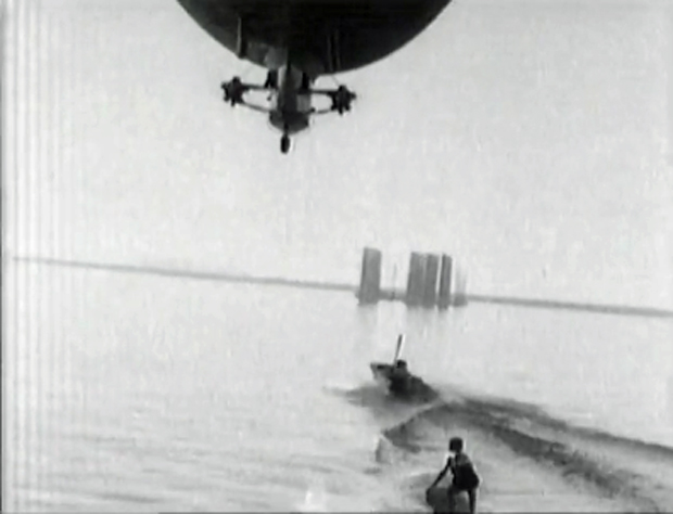 "Image 1 for ""To make King Neptune jealous!"" Blimp tows surfboard rider, 1931"