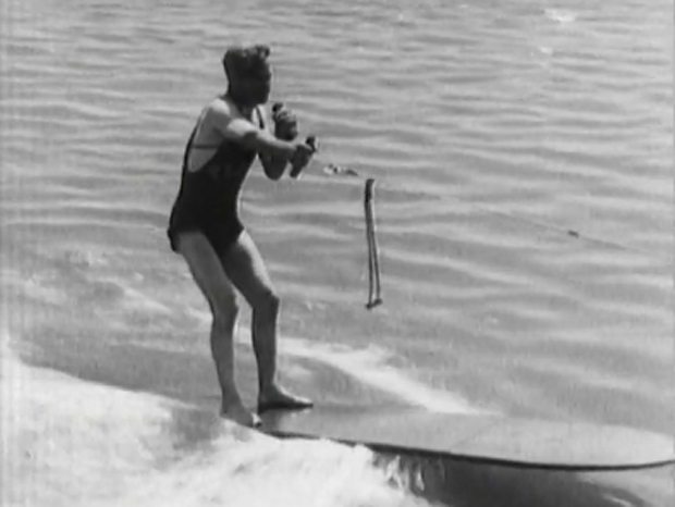 "Image 2 for ""To make King Neptune jealous!"" Blimp tows surfboard rider, 1931"