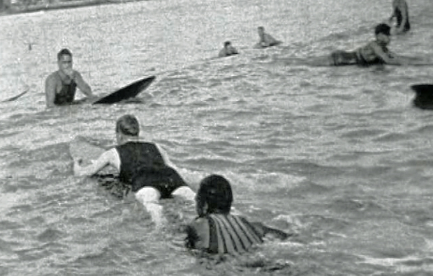 Image 1 for Edward, Prince of Wales, goes surfing in Hawaii in 1920 (he's not very good).